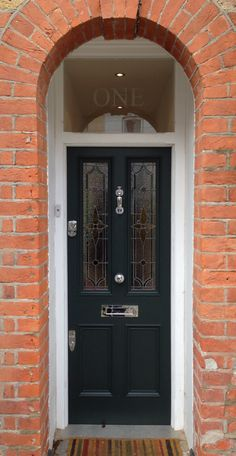 A pleasant Victorian front door with leaded light in Farrow & Ball's Studio Green no. 93 in exterior eggshell, East London