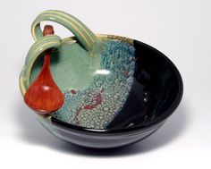 Fat Cat Pottery - love the handle and the glazes