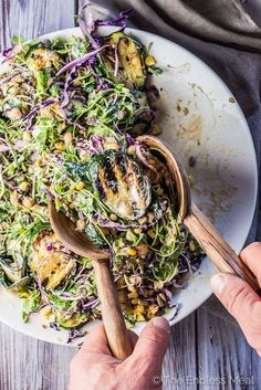 I have been told that this Grilled Zucchini Salad is THE BEST salad ever. It's loaded with summertime favorites like grilled zucchini and corn, alfalfa sprouts, purple cabbage, and healthy chickpeas and tossed in a super creamy and easy to make sunflower seed dressing. It's a healthy side dish that is naturally vegan + gluten-free. | theendlessmeal.com