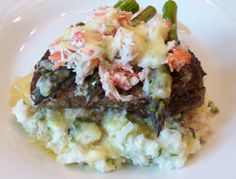 Filet Oscar- the ultimate dinner! Filet mignon with fresh crab meat topped with asparagus and bearnaise sauce all over cauliflower mashed potatoes.