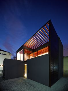 Pergola is a minimalist house located in Saitama, Japan, designed by APOLLO Architects & Associates. The two-story wooden structure is characterized by a series of vertical slats that overlays the roof. (12)