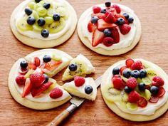 Individual Fruit Pizzas: Ree Drummond tops homemade cookie crusts with a creamy mixture and serves them with a platter of fruit. Let your guests build their own sweet pizza with as much fruit as desired.