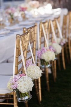 hydrangea bouquets hanging from the dining chairs Photography by Jonathan Young Photography / jyweddings.com, Event Design   Planning by Merrily Wed / merrilywed.com, Floral Design by Art In Bloom / artinbloomfloral.com