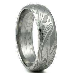 Hey, I found this really awesome Etsy listing at https://www.etsy.com/listing/181096419/damascus-steel-mens-wedding-band-four