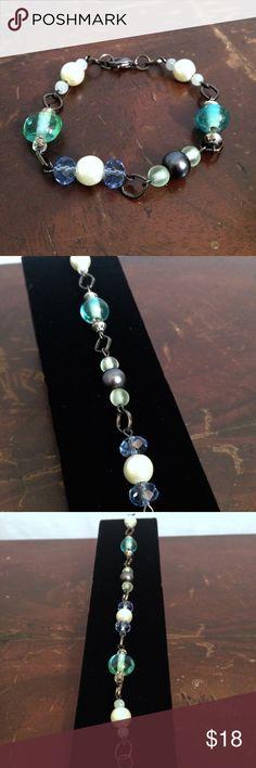 "Handmade Blue Green and Cream Bead Bracelet Handmade bracelet with gunmetal link, cream pearl, faceted blue Bead, sea blue hand blown Bead, green pearl, and gray pearl beads. Lobster clasp, 7 1/2"" length. Skylark Vintage Jewelry Bracelets"