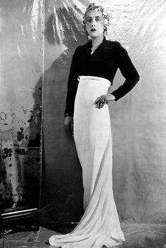 1929 - Schiaparelli wearing an outfit of her own design.