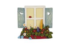 This beautiful hanging window has a flower box just bursting with blooms!