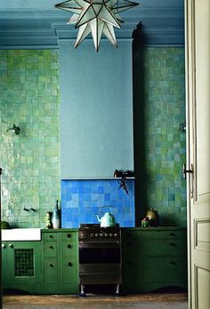 moroccan influenced kitchen entire wall covered in sea glass colored tile