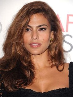 Eva Mendes showing off her hair's natural texture and embracing frizz | allure.com