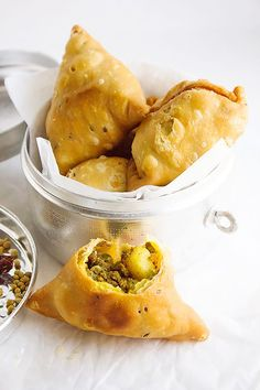 These samosas are filled with ground beef, potatoes, and green peas.