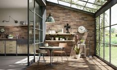 Kitchen with outdoor designs: this dining room spills out into the garden | Marazzi Ceramiche, collection Terramix | @marazzitile