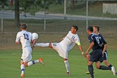 Marcos Meneses stretches out to control the ball.
