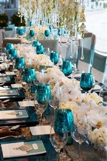 Metallic blue goblets added a pop of color to the white and silver table.
