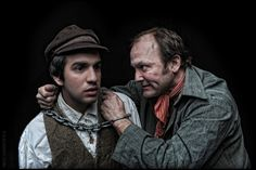 Eric Scotolati (left) portrays Pip and Paul Kuhn (right) portrays Magwich in Curio Theatre Company's production of GREAT EXPECTATIONS. (Photo credit: Kyle Cassidy)