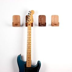 5 Simple Yet Stylish Ways to Display Stringed Instruments   Apartment Therapy  What a good way to showcase and protect Ben's guitar.