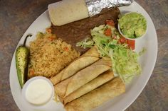 Our Flautas plate:  Fried tortillas stuffed with shredded chicken rice, refried beans, two house-made tortillas & sides of guacamole and sour cream. Served daily, 11am - 3pm.  www.ElMilagritoCafe.com