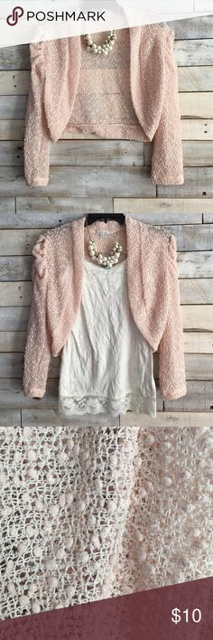 Dressy 3/4 sleeve crop shrug Pale pink dressy crop shrug. Sleeves are 3/4 length. There sequins and a faint trace of glitter to make this top sparkle! Like new, only worn once Charlotte Russe Tops