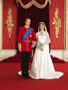 The royal couple poses in the Throne Room at Buckingham Palace on April 29, 2011 in London.