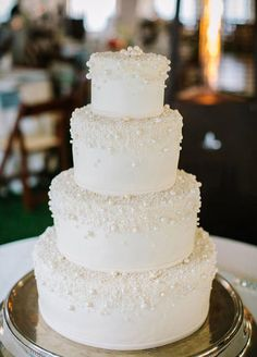 Featured Photographer: Pure 7 Studios; Glamorous four tier pearl studded white wedding cake