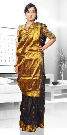 Beautiful Black Colour Pat Guna Assam Silk Saree with artistic Guna work of small buta giving an unique look to the collection. This saree can be used as both wedding and festival Saree.The Saree comes with matching blouse piece, the blouse shown in the image is just for display purpose.Slight colour variation may be there in display & actual.