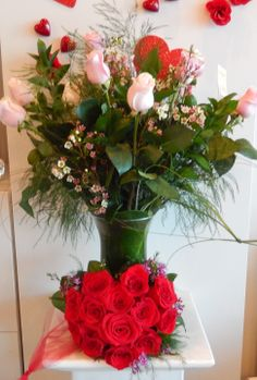 Vase of a dozen roses with rose heart in front , both available from Dizennio Floral Boutique-Vaughan
