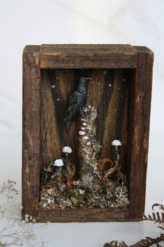 Realistic texture has been used to create a sense of being in a real forest. The use of similar natural wood materials creates unity in the design. Wooden Shadow Box, Shadow Box Art, Barn Wood Crafts, Rabe, Arte Popular, Assemblage Art, Collage Art, Art Collages, Altered Art