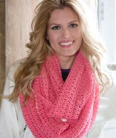 An easy crochet pattern and a thin yarn create a lightweight infinity scarf suitable to wear year round. Wrap it twice like our fashion-styled model, or wrap it three times if you're cold.