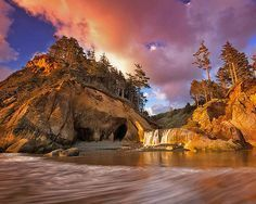 """A perfect spot to embrace Nature  Hug point, Oregon coast,  Oregon, USA  photo by: Unknown  Late 19th century stagecoaches that used the beach as a highway """"had to 'hug' this particular point even at low tide to get around it"""", hence the name Hug Point. Hug Point State Recreation Site is a state park on the northern Oregon Coast in the U.S. state of Oregon. The park is 5 miles (8.0 km) south of Cannon Beach along U.S. Route 101, include picnicking, fishing, and a Pacific Ocean beach."""