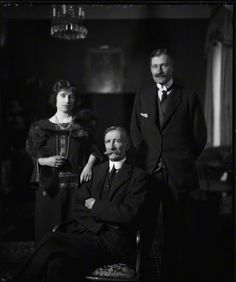 Lady Elizabeth Bowes-Lyon with her father and brother