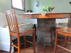 We were sick of knocking our knees on the table legs, so we removed them and made a whiskey barrel pedestal.