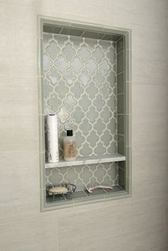 tile shower niche - love the inset pattern