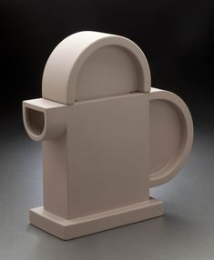 "Collections - mbam.qc.ca CLOSE Ettore Sottsass Cinnamon Teapot From the series ""Indian Memory""  1972 (example of 1987)  Partially glazed earthenware  26 x 24.7 x 9 cm  Produced by Alessio Sarri Ceramiche, Sesto Fiorentino, Italy"