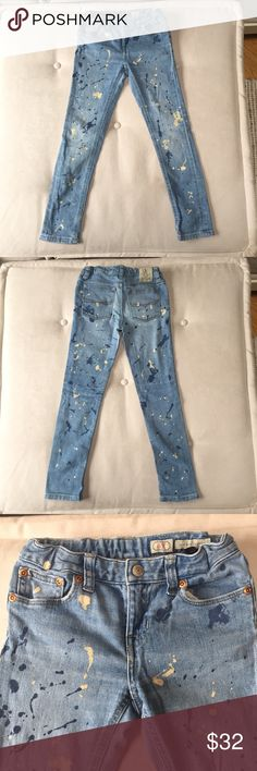 """Ralph Lauren Girls Paint-Splotch Skinny Jeans Coolest jeans ever!  Bowery Skinny style. Medium wash with ivory and blue paint splotches.  Front snap closure and adjustable elastic waistband straps inside- see photo.  Measures across: elastic band waist 10"""" , inseam 21"""", zipper 2"""", rise 6 1/2"""" (at front from bottom middle seam to waistband top).  Great condition- worn twice and handwashed once, no holes or stains. I wish they made these in my size!! :) Ralph Lauren Bottoms Jeans"""