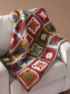 This cozy afghan adds a great splash of color anywhere. (Lion Brand Yarn)
