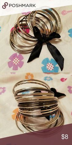 Bangles Set Silver and blackish gray. It have unique patterns and design. Jewelry Bracelets