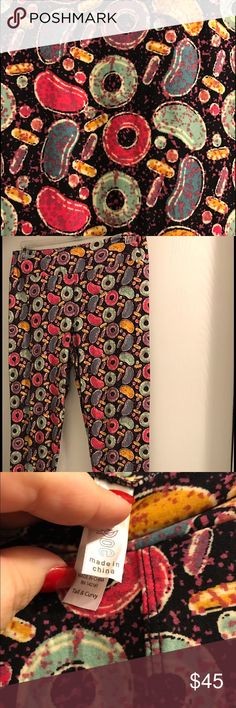 NWT TC Lularoe Leggings NWT TC Lularoe Leggings.  Made in China. Background is black with multi colored life savers and jelly beans. So cute! LuLaRoe Pants Leggings