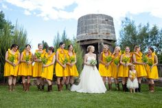 Love everything about this: landscape, cowboy boots, bouquets and punchy yellow.