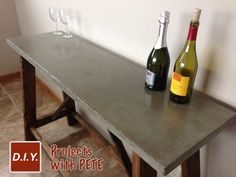 How to make a beautiful concrete table. It's a cheap and fun project!