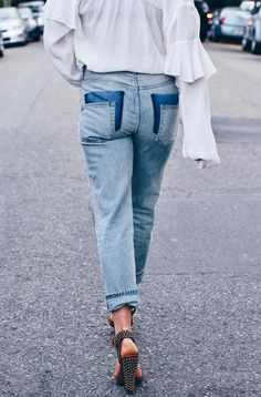 I have an obsession with reworking denim. The addiction has justified my reasoning for never getting rid of jeans, much to my husband's chagrin, no matter how old they are. Really, there's nothing that a pair of scissors can't overhaul. To date, we've patched holes, fringed cuffs, embroidered
