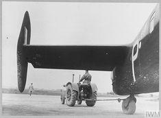 History Pics, World History, Handley Page Halifax, Ww2 Aircraft, Aeroplanes, Nose Art, Royal Air Force, Tractor, Caption