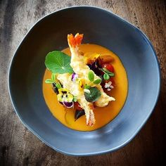 Sage pumpkin gnocchi, crispy king prawn tempura and spiced butter tomato fondue