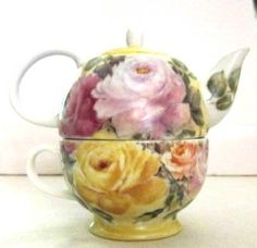 Porcelain teapot painted with roses by jeannette otero