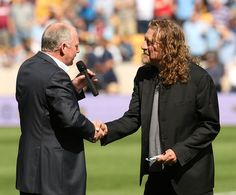 August 2009-Wolverhampton Wanderers president Steve Morgan congratulates Robert Plant on being named Third Vice President of the club.