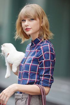 Leaving her apartment with her cat Olivia in NYC 9/25/14
