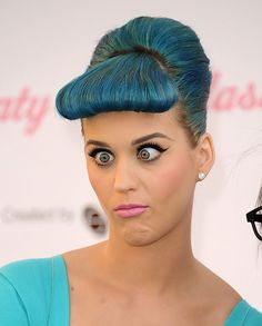Katy Perry goes cross-eyed at the launch of her new false eyelash range by Eylure at The Americana at Brand in Glendale, California on February 22nd, 2012. // There's something intensely cartoonish about her