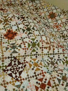 Pattern by Sue Garmin  Karina Carson Oh my heavens. It's called the Oh My Gosh quilt. Those little squares are 1 inch unfinished/ 1/4 inch finished.