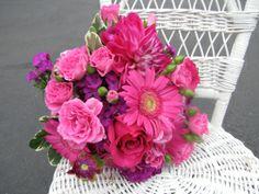 Monochromatic bouquet of gerbera daisies, roses, dahlias, sweet william, etc