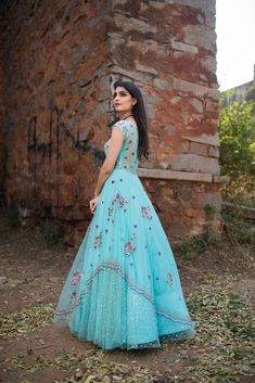 Bring in the mood of turquoise waters and waves into the celebration. Beautiful turquoise color long gown with hand embroidery work. Indian Wedding Gowns, Indian Gowns Dresses, Pakistani Dresses, Indian Bridal, Long Gown Dress, Frock Dress, Indian Designer Outfits, Designer Dresses, Nice Dresses