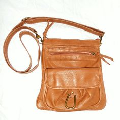 Tan Crossbody Purse Only used once, still clean & basically new.  Adjustable strap. Several pockets front back & inside purse. This is not leather.  Very casual & practical. Bags Crossbody Bags