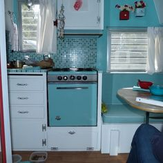 Old trailer interior - I would take out the stove and add more storage. Love the tile behind the stove though!